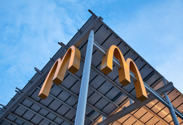 McDonald's arches on the corner of a building